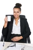 Young office worker holds a cup Royalty Free Stock Photo