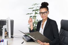 Young office worker holds a file Royalty Free Stock Photo