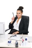 Young office worker holds a pen Stock Photography