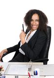 Young office worker sits at the desk Royalty Free Stock Image
