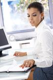 Young office worker sitting at desk Royalty Free Stock Photography