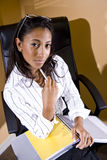 Young office worker sitting with notebook ready to Royalty Free Stock Photo