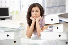 Young office worker sitting troubled in office Stock Images
