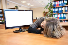 Young office worker sleeping at working place Royalty Free Stock Image