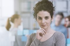 Young office worker smiling and posing stock images