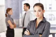Young office worker standing arms crossed Royalty Free Stock Images