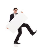 Young office worker walking with placard. Royalty Free Stock Photos