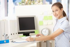 Young office worker woman at desk Stock Photos