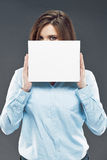 Young office worker woman hiding face behind  banner. Royalty Free Stock Image