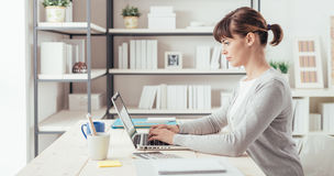 Young office worker working at desk stock photo