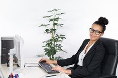 Young office worker works at the pc Stock Images