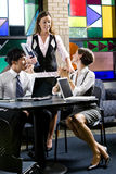 Young office workers in colorful meeting room Royalty Free Stock Photo