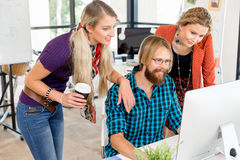 Young office workers discussing Stock Photography