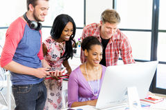 Young office workers or students as a team Royalty Free Stock Image