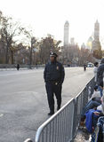 Young officer walking Macy's route. NEW YORK CITY, NY - NOVEMBER 28 : Young NYC Officer walking W 59th ST piror to the Macy's 87th Annual Thanksgiving Day Parade Stock Photos