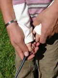 Young & Old. Father helping his son with his Golf grip Royalty Free Stock Photos
