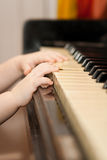 Young and old. Young hands playing the old piano Royalty Free Stock Photo