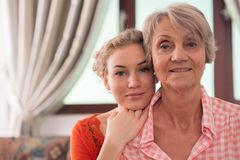 Young and old. Close-up portrait of young and elderly women of the same family royalty free stock image