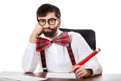 Young old fashioned man writing with big pencil. Royalty Free Stock Photography