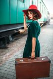 Young old-fashioned woman travels on retro train Royalty Free Stock Photos