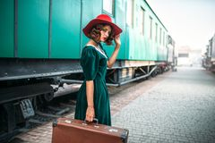 Young old-fashioned woman travels on retro train Stock Photography