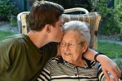 Me and grandma, boy visits his great-grandma stock photos