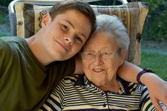 Me and grandma, boy visits his great-grandma royalty free stock photo