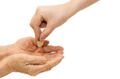 Young and old hand with a coin Royalty Free Stock Image