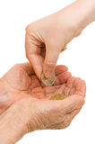 Young and old hand with a coin Stock Photos