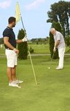 Young and old man golfing together Stock Images