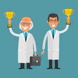 Young and old scientist holding cup Royalty Free Stock Photo
