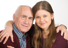 Young and old. Young women hugging old senior man Royalty Free Stock Photos