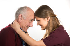 Young and old. Young women hugging old senior man Stock Photo