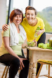 Young and older women with healthy food indoors Royalty Free Stock Images