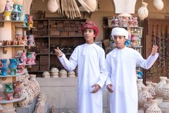 Young Omani boys performing a song in a traditional outfit. Royalty Free Stock Photo