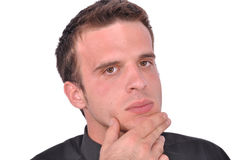 Young oncerned man is thinking Royalty Free Stock Image
