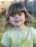 Young one. A cute young girl smiling at camera stock image