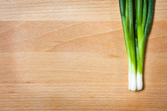 Young onion on cutting board Stock Photos