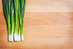 Young onion on cutting board Royalty Free Stock Image