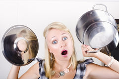Shocked caucasian woman holding empty cooking pot Stock Photo