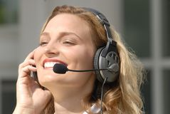 Young operator. Female operator smiling with headset including microphone stock photos