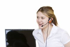 Young operator. Young woman with headset talking online stock photo