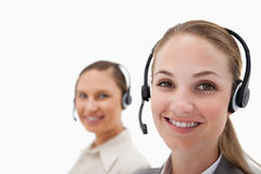 Young operators using headsets Royalty Free Stock Photos