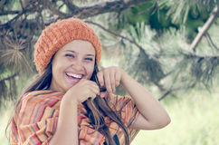 Young orangehead girl in warm autumn dress. Standing outdoor, laughting Royalty Free Stock Photos