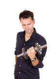 Young ordinary business man lifting dumbbells Royalty Free Stock Photo