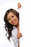 Young Oriental businesswoman with sign Royalty Free Stock Photography