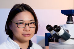 Young oriental microscopist Stock Photography