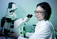 Young oriental scientist Stock Images