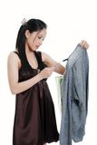 Young oriental woman checking a sales tag Royalty Free Stock Photos