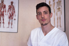 Young osteopath in his office Royalty Free Stock Image